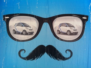 Hipster fads sell cars - poster in downtown Toronto